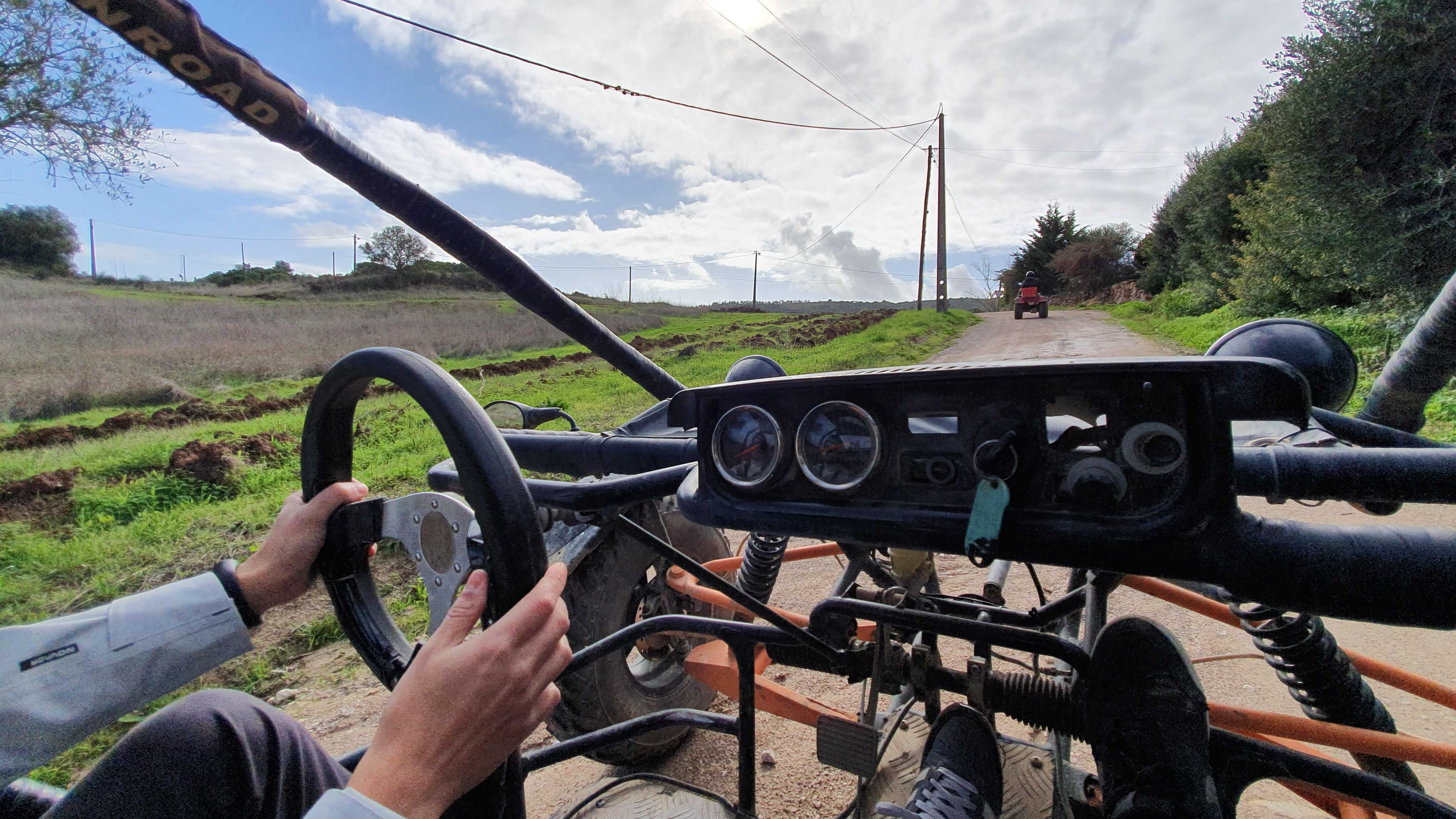 The picture is from one of the squad dynamics activities. It shows one person at the wheel of a car, driving on a road in the middle of a country.