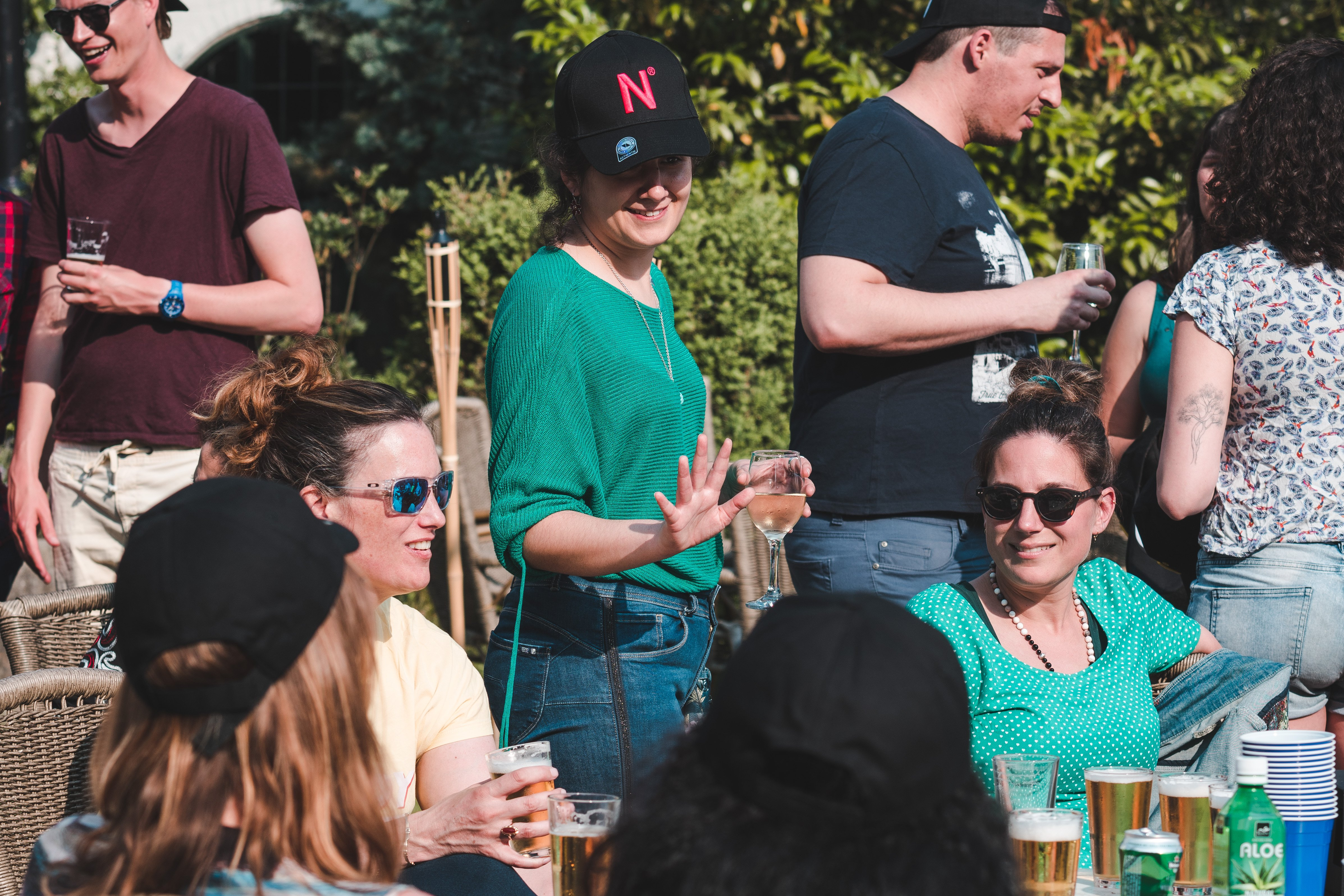 Rita, our Recruitment Lead, is talking to some of our colleagues during our Summer Event of 2019. They're sitting in a nice round table in the sun, drinking some beers and using the opportunity to connect to everyone.